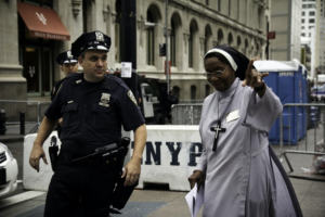 policeman speaking to a nun