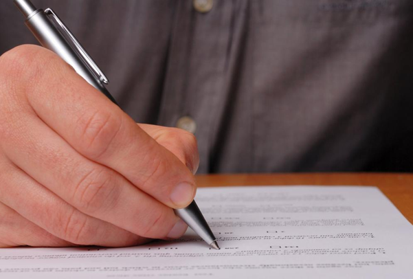 A man writing with pen