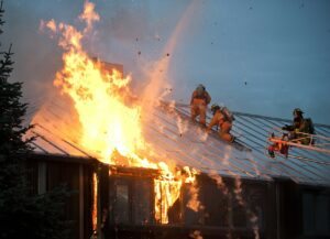 Firefighters extinguishing flames in a building