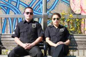 Two police officers sitting on a bench