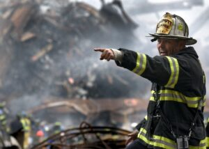 A firefighter working in the rubble