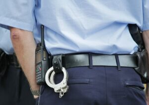 A cop wearing a blue uniform