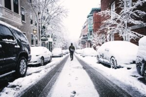 A person walking on an iced street