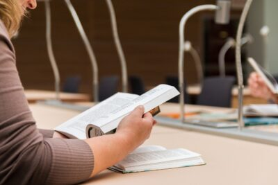 person reading books in a library